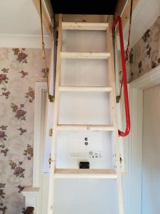 Timber loft ladders with hand rail
